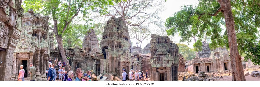 Siem Reap, Cambodia - March 26, 2019 :  Tourists in panorama of Ta Prohm temple in Angkor Complex in Cambodia.