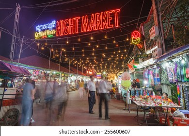 "SIEM REAP, CAMBODIA - NOV 16, 2014: tourists walking around at the night market of Siem Reap on Nov 16,2014. Siem Reap have many night market, this one call ""Original Noon"""
