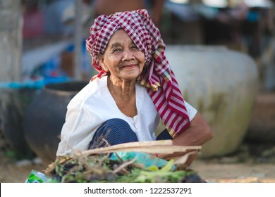 Siem Reap/ Cambodia- November 15 2018: happy smile of a old women in cambodia with a traditional headscarf