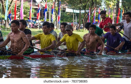 SIEM REAP, CAMBODIA: NOVEMBER 2016: Medium view of ceremonial boat racers in Cambodia after crossing the finish line during the leadup to the annual water festival boat races in Siem Reap, Cambodia.