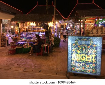 SIEM REAP, CAMBODIA - NOVEMBER 2017: Unidentified tourists shop at the Angkor night market. The city serves as a gateway to the world famous Angkor temples and is a major tourist hub.