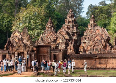 Siem Reap, Cambodia - November 24 2015: A goup of tourists is visiting a temple in Angkor Wat temple complex