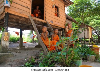 SIEM REAP, CAMBODIA - NOVEMBER 26: Novice monks outside their housing accommodation in the countryside of Siem Reap, Cambodia on the 26th November, 2013.