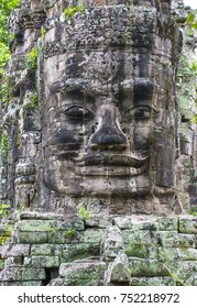 SIEM REAP , CAMBODIA - OCT 15 : Stone face at the bayon temple in Angkor Thom, Siem Reap Cambodia on October 15 2017 , Angkor Thom was the last and capital city of the Khmer empire.
