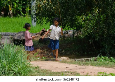 SIEM REAP, CAMBODIA - OCTOBER 19, 2016: Kids are fishing with bamboo rod