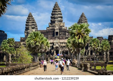 Siem Reap, Cambodia - October 20,2018 : Tourist from around the world are walking in front of Angkor Wat,Angkor Wat is a temple complex in Cambodia and one of the largest religious monuments