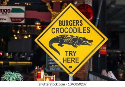 Siem Reap, Cambodia - October 22 2018, funny burgers crocodiles try here street food sign in Siem Reap, Cambodia