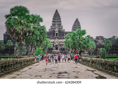 SIEM REAP, CAMBODIA - OCTOBER 23, 2015: Tourists walking around Angkor Wat, the famous old palace in Siem Reap, Cambodia at the year of 2015.