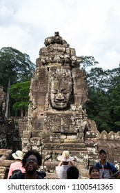 Siem Reap, Combodia - 22 May 2018:  travelers are visiting and taking photo of smiling face stone in Bayon temple in Angkor Thom, Siem Reap province, Cambodia