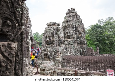 Siem Reap, Combodia - 22 May 2018:  travelers are visiting and taking photo with smiling face stone in Bayon temple in Angkor Thom, Siem Reap province, Cambodia