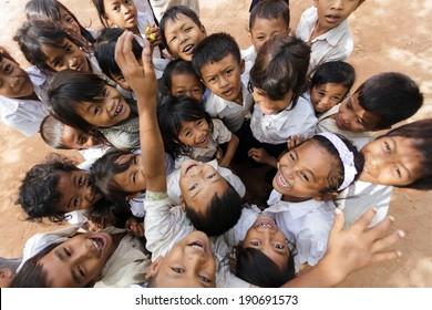 SIEM REAP -DECEMBER 04: group of joyful kids posing in a schoolyard on December 04, 2012 in Siem Reap, Cambodia