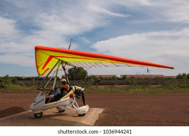 Siem Reap, Siem Reap Province, Cambodia - November 28 2015 : Pilot sitting with passenger in a microlight aircraft on the runway, in Siem Reap
