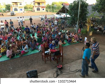 SIEM REAP PROVINCE, CAMBODIA - NOVEMBER 2017: Local country people sitting in a yard listen to preaching the Gospel.