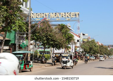 Siem Reap, Siem Reap Province / Cambodia - October 27 2019: Tuk tuk and vehicles on the street. Moto and trailer taxi and Indian style three wheeled tuktuk.