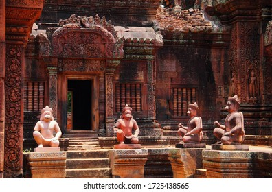 SIEM REAP/CAMBODIA - JAN 04. Ancient stone statues of monkey guardian (vanara) and beautiful decorated walls on January 04, 2020 in Banteay Srei (Srey) temple, Angkor archaeological complex, Cambodia.