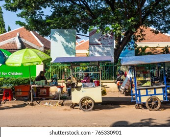 Siem reap,Cambodia - October 5 2017 : tuk tuk car or motorcycle taxi and traffic on the street in Siem reap ,Cambodia