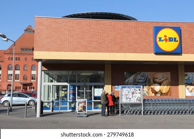 SIEMIANOWICE SLASKIE, POLAND - MARCH 9, 2015: People visit Lidl discount store in Siemianowice Slaskie. Lidl is present in 29 European countries, with more than 500 locations in Poland.