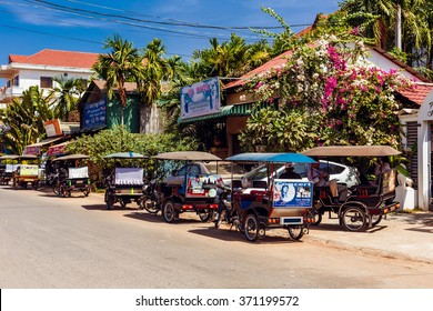 SIEMREAP, CAMBODIA - JAN 25, 2016: Local taxi - tuk-tuk parked on the road