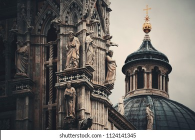 Siena Cathedral closeup with dome and statue as the famous landmark in medieval town in Italy.