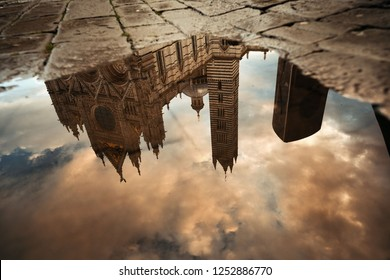 Siena Cathedral reflection after rain as the famous landmark in medieval town in Italy.