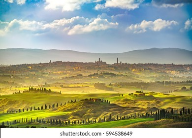 Siena city panoramic skyline, countryside and rolling hills in a misty day. Tuscany, Italy, Europe.