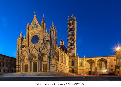 Siena. Italy. 05.07.17. The 12th century Siena Cathedral (The Duomo) at dusk. A masterpiece of Italian Romanesque-Gothic architecture.