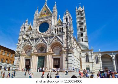 Siena, Italy; 08/11/2014: Siena Cathedral (Duomo di Siena, Metropolitan Cathedral of Saint Mary of the Assumption or Cattedrale Metropolitana di Santa Maria Assunta) in Piazza del Duomo (Duomo Square)