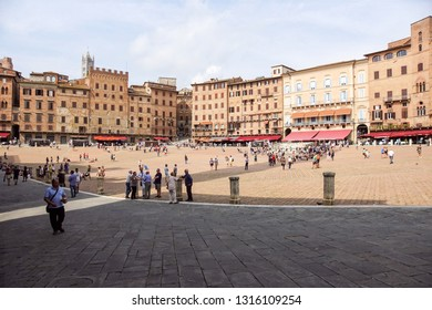 SIENA , ITALY 10 JULY 2018 : Panorama of Piazza del Campo Campo square , Palazzo Publico and Torre del Mangia Mangia tower in Siena, Tuscany, Italy