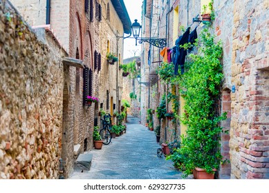 SIENA, ITALY - APRIL 25, 2017 -  Alleys and small stone roads in the Renaissance city of Colle Val d'Elsa in the province of Siena, Tuscany