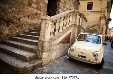 Siena, Italy - Aug 6, 2018 - Fiat 500 parked on a street in Siena, Tuscany