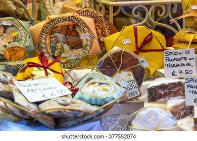 SIENA, ITALY - AUGUST 07, 2015: Sweet cakes with price in the store in Siena, Italy.