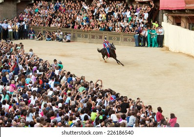 """SIENA, ITALY - AUGUST 15: Preliminary races """"Palio di Siena"""" in medieval square """"Piazza del Campo"""" on August 15, 2014 in Siena, Italy. Race is held twice every year"""