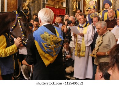 SIENA, ITALY - AUGUST 16, 2008: blessing of a horse before the Palio of Siena, Italy