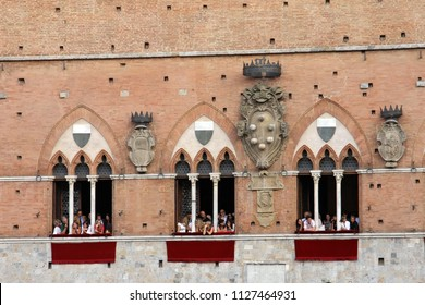 SIENA, ITALY - AUGUST 16, 2008: Palio di Siena, Tuscany, Italy. Colourful historical bareback horse race. Held in the beautiful, historical Piazza del Campo. Exciting event.