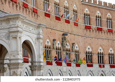 SIENA, ITALY - AUGUST 16, 2008: Piazza del Campo is the main square of Siena with view on Palazzo Pubblico and its Torre del Mangia.