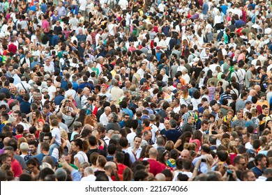"""SIENA, ITALY - AUGUST 16: Spectators in anticipation of start of annual traditional Palio di Siena horse race in medieval square """"Piazza del Campo"""" August 16, 2014 in Siena, Italy"""