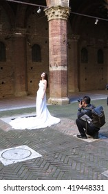 SIENA, ITALY - CIRCA APRIL 2016: Asian bride posing for her photobook in an historical location