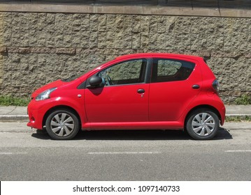SIENA, ITALY - CIRCA JULY 2016: red Toyota Yaris car parked in a street of the city centre