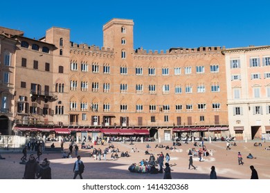 SIENA, ITALY - FEBRUARY 5, 2019 - Scenic view of Campo square (Piazza del Campo) with tourists and relaxing people