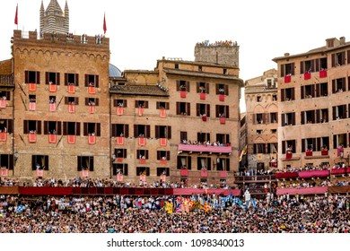 Siena, Italy - July 02 2012: The actual horserace for Palio di Siena lasts a whole few minutes, in Siena (Italy).