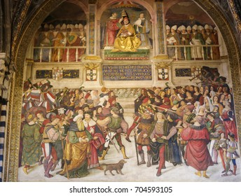 SIENA, ITALY - JULY 10, 2017: Frescoes (1502) in Piccolomini Library in Siena Cathedral, Tuscany, Italy, by Pinturicchio depicting a scene in the Life of Pope Pius II