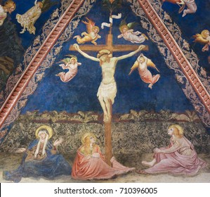 SIENA, ITALY - JULY 10, 2017: Fresco (1450) by Vecchietta in the Siena Baptistery of San Giovanni at the Cathedral of Siena, depicting Jesus on the Cross