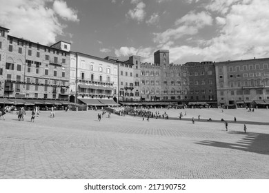 SIENA, ITALY - July 26 2014: Tourists are walking in Piazza del Campoin on July 26 2014 in SIENA, ITALY (black and white)