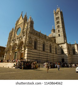SIENA, Italy - JUNE, 23, 2017: Main cathedrale in Siena, Toscana, Italy during afternoon with lot of tourists all around it on June 23. 2017.