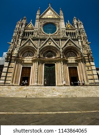 SIENA, Italy - JUNE, 23, 2017: Main cathedrale in Siena, Toscana, Italy front view during afternoon with lot of tourists all around it on June 23, 2017.
