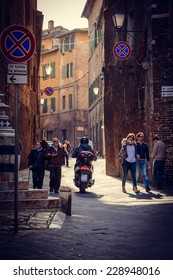 SIENA, ITALY - MARCH 29, 2014: People on the street of the ancient Italian city Siena, Tuscany region, Italy. Toned picture
