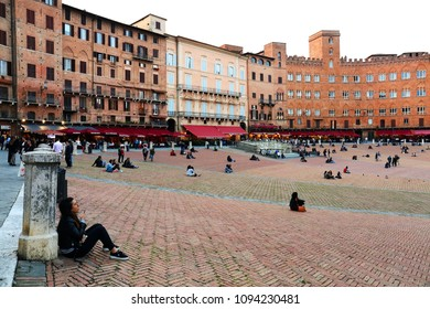 SIENA ITALY - May 10 2018: tourists enjoy Piazza del Campo square in Siena Italy. The historic centre of Siena has been declared by UNESCO a World Heritage Site