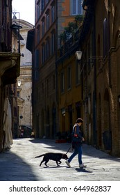 Siena, Italy - May 11, 2014:  people in the streets of the city