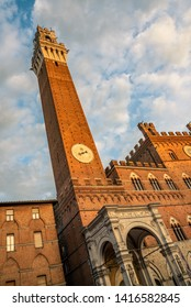 Siena, Italy - May 24 2019:  Piazza del Campo (Campo square), Palazzo Publico and Torre del Mangia (Mangia tower) in Siena, Tuscany, Italy