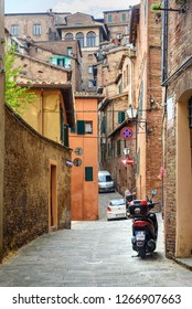 Siena, Italy - October 06, 2018: Medieval narrow street Via Lombarde in old city Siena